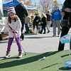 The Westminster Cracker Festival was held on Saturday, Oct. 19, 2019 in Westminster. Lily Huguenin, 7, from Westminster tries some golf during hte festival. the prize at this booth was a $50 gift certificate to the Albatross Restaurant at the Westminster Country Club. SENTINEL & ENTERPRISE/JOHN LOVE