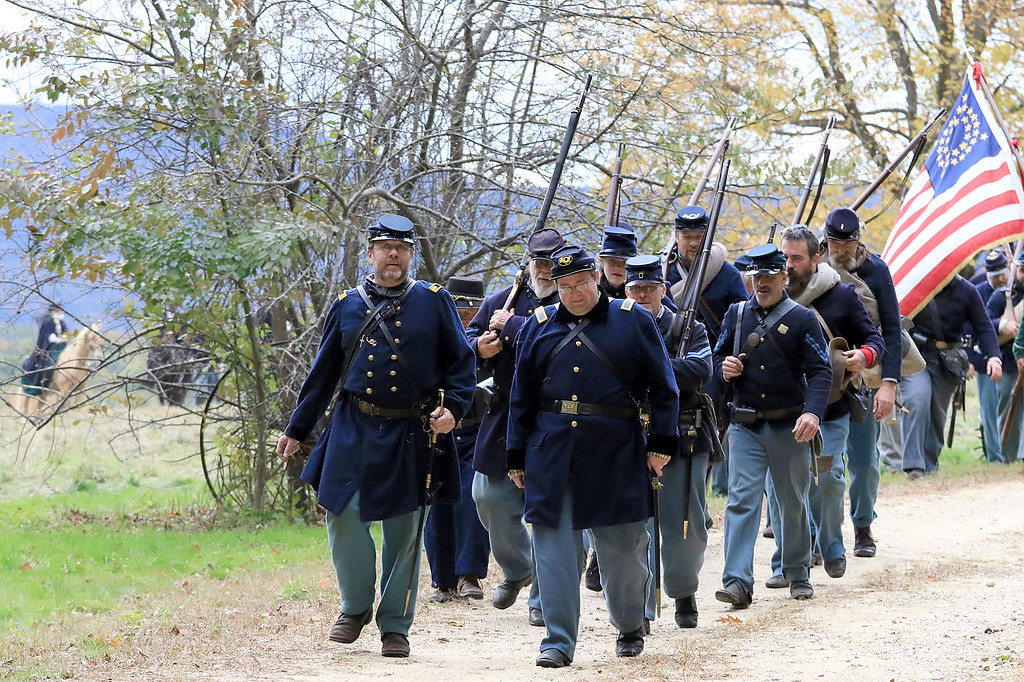 . The annual Cracker Festival was held in Westminster on Saturday, October 20, 2018. The 15th MA Volunteer Infantry makes their way back to their camp on the town common after their battle reenactment during the festival. SENTINEL & ENTERPRISE/JOHN LOVE