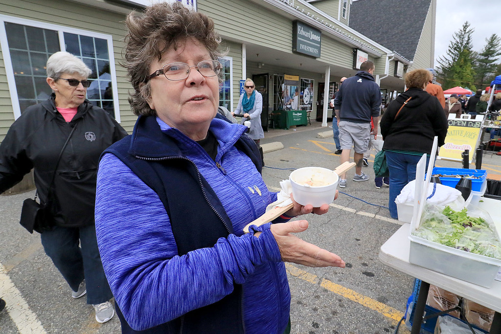. The annual Cracker Festival was held in Westminster on Saturday, October 20, 2018. Evelyn Dolan of Fitchburg talks about how she ran the 5K they had to start off the festival and how mush she was enjoying the festival as she ate some seafood chowder from the Angler Fish Market & Chowder Co. SENTINEL & ENTERPRISE/JOHN LOVE