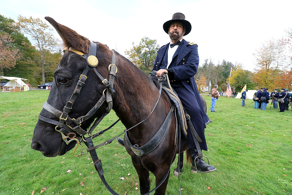 . The annual Cracker Festival was held in Westminster on Saturday, October 20, 2018. Sam Grant of Townsend playing General Ulysses S. Grant rides his horse Jefferson Davis as he helps the 15th MA Volunteer Infantry with their reenactment during the festival. SENTINEL & ENTERPRISE/JOHN LOVE