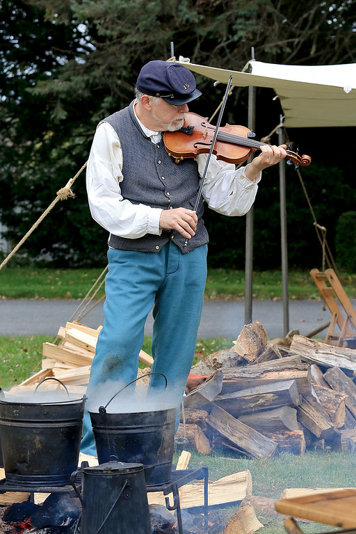 . The annual Cracker Festival was held in Westminster on Saturday, October 20, 2018. Alan Filo Dudley with the 15th MA Volunteer Infantry plays the fiddle at their camp on the town common after their battle reenactment during the festival. SENTINEL & ENTERPRISE/JOHN LOVE