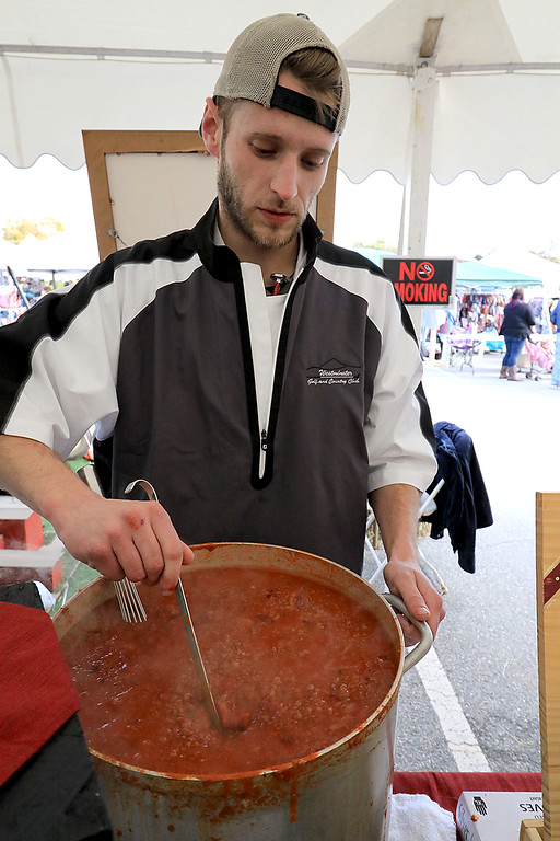 . The annual Cracker Festival was held in Westminster on Saturday, October 20, 2018. Shane Murray with the Westminster Country Club gets their gluten free venison chilli ready for the chilli cook off at the festival. SENTINEL & ENTERPRISE/JOHN LOVE