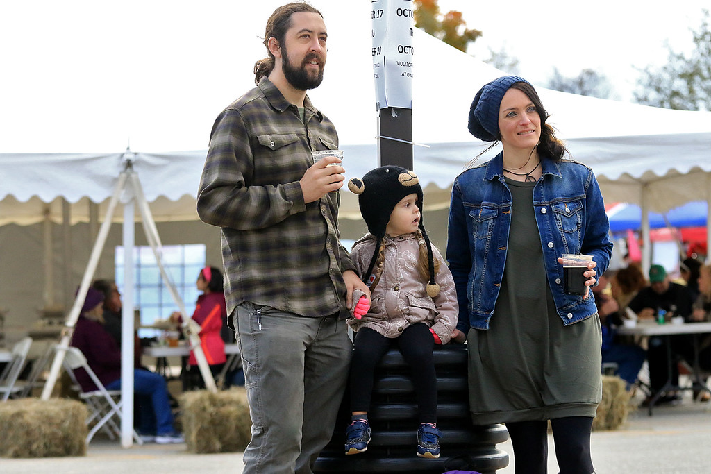 ". The annual Cracker Festival was held in Westminster on Saturday, October 20, 2018. The group ""Tribe\"" performed on stage for the crowds at the festival. Listening to the band is, from left, Isaiah Grigos, Hazel Grigos, 3, and Emily Grigos all of Westminster. SENTINEL & ENTERPRISE/JOHN LOVE"
