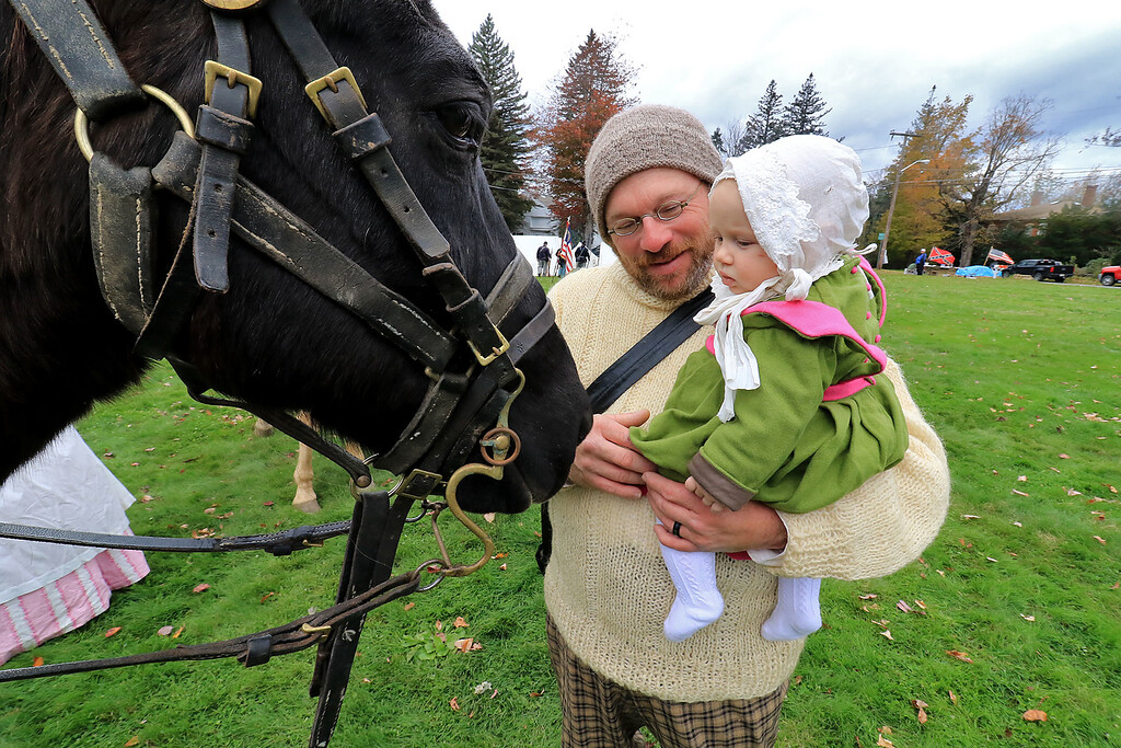 . The annual Cracker Festival was held in Westminster on Saturday, October 20, 2018. David Lieber holding his daughter Lavender, 7 months, as they met the horse Jefferson Davis owned by Sam Davis who was playing General Ulysses S. Grant during some reenactments with the 15th MA Volunteer Infantry on the town common during the festival. SENTINEL & ENTERPRISE/JOHN LOVE