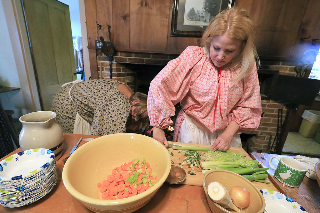 . The annual Cracker Festival was held in Westminster on Saturday, October 20, 2018. Volunteer Carla Curtis was cutting up some vegetables for a soup they where making just like it would have been made in the 1850\'s at the Westminster Historical Society\'s building on Main Street during the festival. SENTINEL & ENTERPRISE/JOHN LOVE