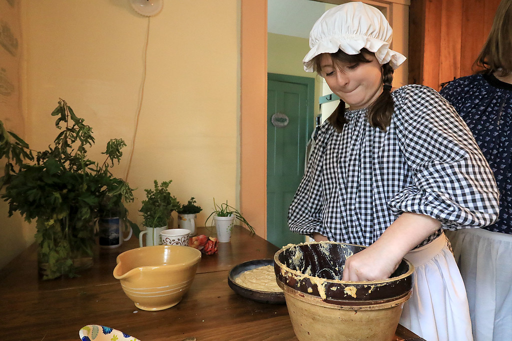 . The annual Cracker Festival was held in Westminster on Saturday, October 20, 2018. Erica Lanciani, 12, was making corn bread at the Historical Society\'s building just like they would have done in the 1850\'s. SENTINEL & ENTERPRISE/JOHN LOVE