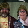 Newlywed's and owners of H&M Farms, Matt Allison and Heather Bowen, of Lunenburg, hide out from the rain in their matching hats during Saturdays Cracker Festival in Westminster.  Sentinel & Enterprise photo/Jeff Porter