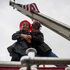 Maggie Connell, 4, with brother Mathew Connell, 9, of Westminster stand on a fire truck during Saturdays Cracker Festival in Westminster.  Sentinel & Enterprise photo/Jeff Porter