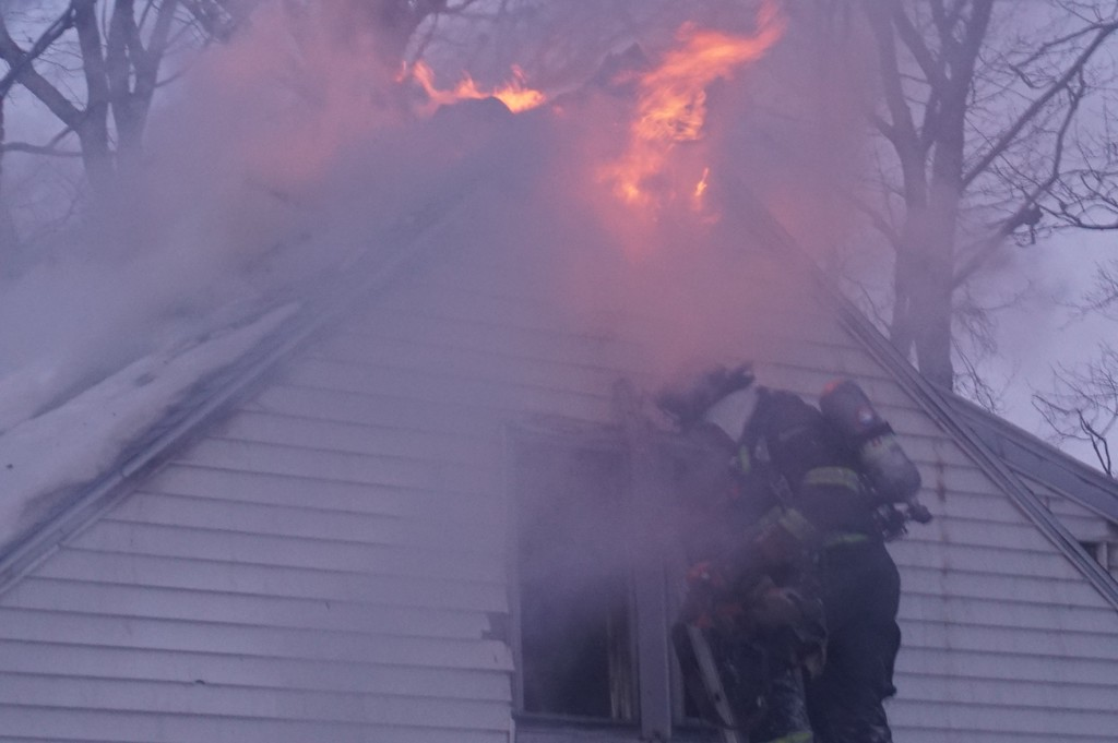 . Firefighters from Westminster, Hubbardston, Leominster, Gardner, Ashburnham, and Fitchburg battle a stubborn fire Friday afternoon at 26 Old Town Farm Road. The two-story wood frame home was heavily damaged. SENTINEL & ENTERPRISE / AMANDA BURKE