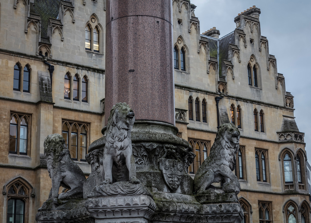 Three stone lions and column in front of Westminster School in London