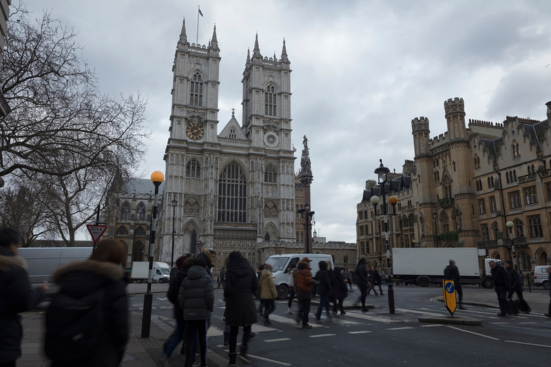 People crossing the road at Westminster Abbey in London