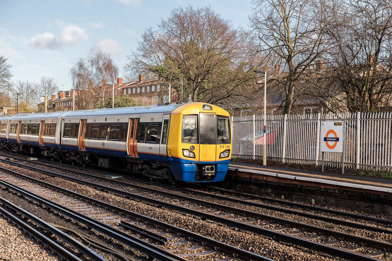 London Overground train arrives at the station in Sydenham South London