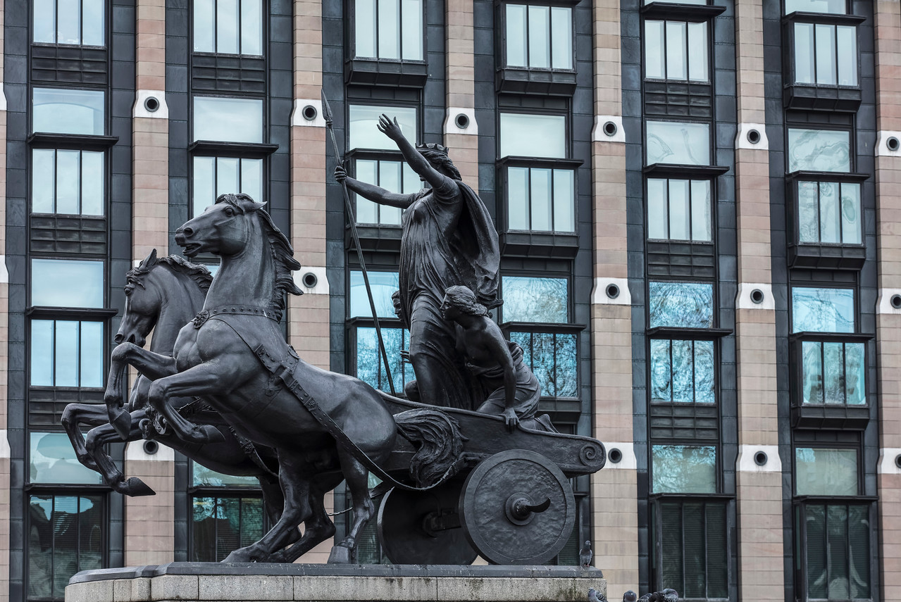 Queen Boadicea statue in front of windows of Trident House on Westminster  Bridge in London