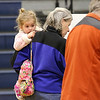 Octavia Feeley, 5, hung out with her grandparents Pat and Bob Freeley as they filled out their ballots at the polls in Westminster on Tuesday at the Westminster Elementary School. SENTINEL & ENTERPRRISE/JOHN LOVE