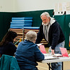 David Whitney checks in at J.R. Briggs Elementary School in Ashburnham during the annual town elections on Tuesday, April 25, 2017. SENTINEL & ENTERPRISE / Ashley Green