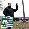 Joshua Schonborg, who was running for school committee, was holding his sign outside the polls as voters pulled into cast their ballots  in Westminster on Tuesday at the Westminster Elementary School. SENTINEL & ENTERPRRISE/JOHN LOVE