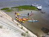 Ship rock beach with kayaks, including John and Mary.