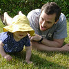 Elizabeth, 11 months, and Unca Jon, in the grass.