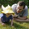 Elizabeth, 11 months, and Unca Jon, in the grass.