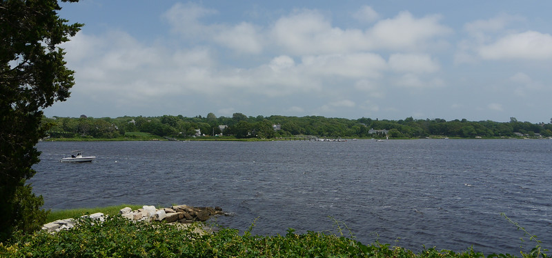 View shows jetty and little beach at Cadman's Neck