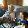 Michael and Great Grandma Allen share photos.  Thanks, Bruce, for capturing this moment.