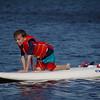 Michael paddles sailboard