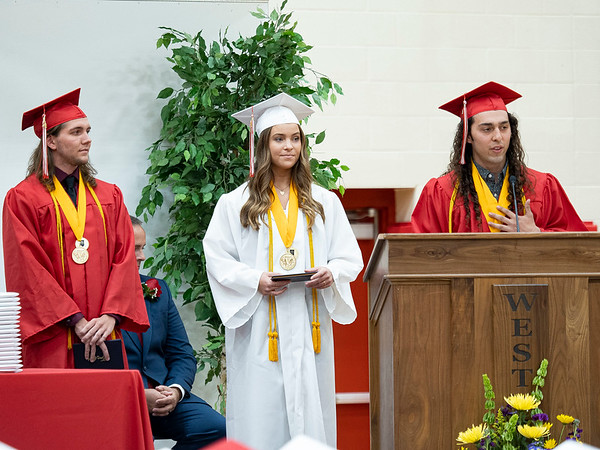 Westview Class of 2021 Senior Co-Valedictorians Joseph Mullett, left, Alexis Miller, center, stand by while Doug Calvillo delivers his speech during Friday's commencement ceremony at Westview Jr./Sr. High School in Topeka. There were 86 seniors who graduated this year.