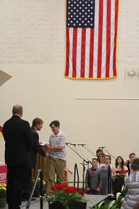 JULIE CROTHERS BEER   THE GOSHEN NEWS Westview Jr-Sr High School eighth-grade student Jamison Garcia receives his certificate from junior high school principal Randy Miller during Friday's eighth-grade promotion ceremony in the school's gymnasium.