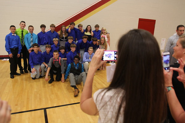 JULIE CROTHERS BEER   THE GOSHEN NEWS A group of Westview Jr-Sr High School students pose for a photo together after the eighth-grade promotion ceremony and junior high awards Friday in the school's gymnasium. School leaders honored 171 eighth-grade graduates Friday, nearly half of which will not return to high school in the fall due to their religious beliefs.