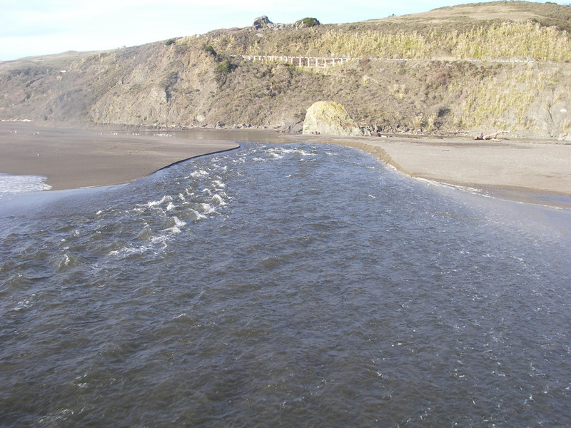 The small opening in the beach where the Russian River flows into the Pacific.