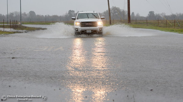 A pickup drives through a flooded section of Stilson Canyon Road as heavy rain arrives in Chico, Calif. Thurs. Dec. 15, 2016. (Bill Husa -- Enterprise-Record)