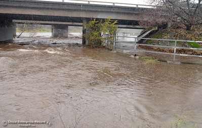 Water in Lindo Channel flows high near the Hwy. 99 bridge as heavy rain arrives in Chico, Calif. Thurs. Dec. 15, 2016. (Bill Husa -- Enterprise-Record)