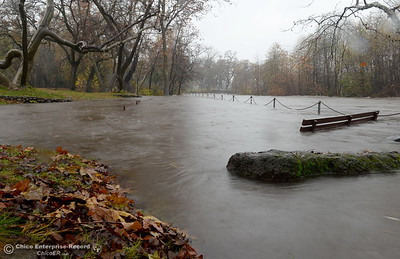 Big Chico Creek floods over the railing above the benches at Five Mile Recreation Area in Upper Bidwell Park in Chico, Calif. as heavy rain arrives in Chico, Calif. Thurs. Dec. 15, 2016. (Bill Husa -- Enterprise-Record)