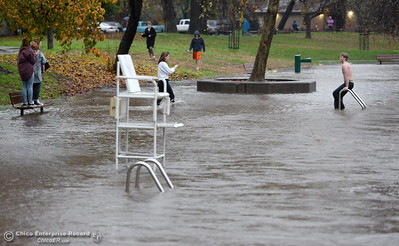 One man braved the cold for a photo opp at Sycamore Pool at the One Mile Recreation Area of Bidwell Park putting some people on edge as he walked out to the ladder in rising waters during heavy rain in Chico, Calif. Thurs. Dec. 15, 2016. (Bill Husa -- Enterprise-Record)