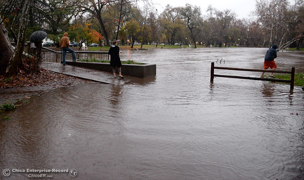 People gather around Sycamore Pool at the One Mile Recreation Area of Bidwell Park to watch the rising waters during heavy rain in Chico, Calif. Thurs. Dec. 15, 2016. (Bill Husa -- Enterprise-Record)