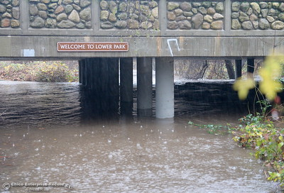 Big Chico Creek floods over the bike path at the entrance to Lower Bidwell Park in Chico, Calif. as heavy rain arrives in Chico, Calif. Thurs. Dec. 15, 2016. (Bill Husa -- Enterprise-Record)