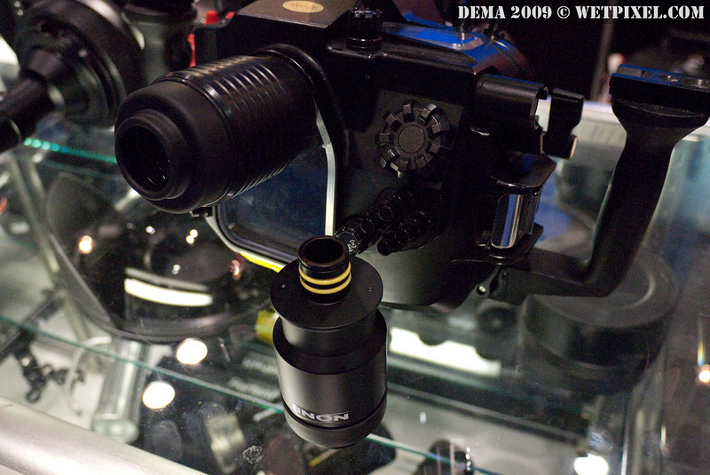 Old-school 180-degree straight INON viewfinder and new model (on table) installed in a Sea & Sea housing
