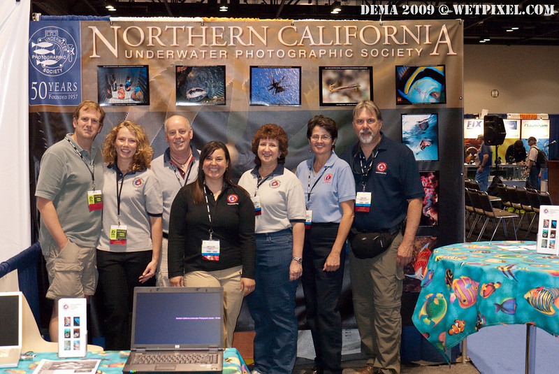 The NCUPS team at their booth, which is right next to ours!