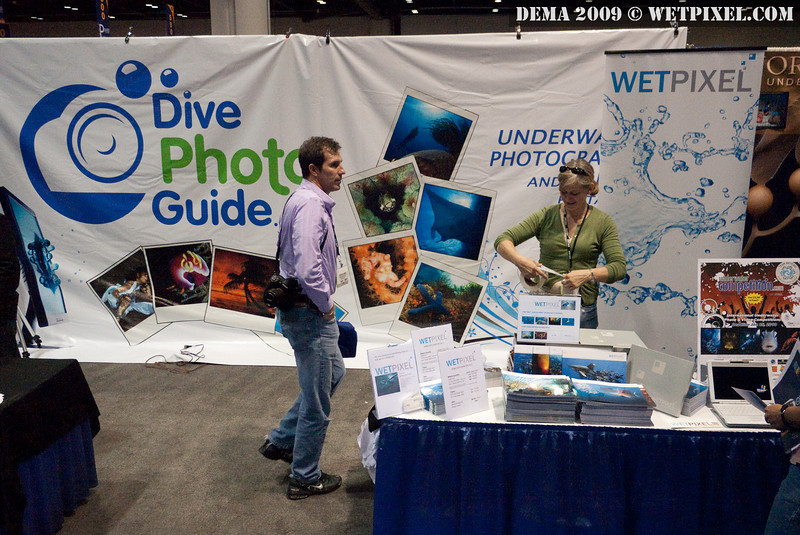 Michaela preps the Wetpixel / DivePhotoGuide booth #1068