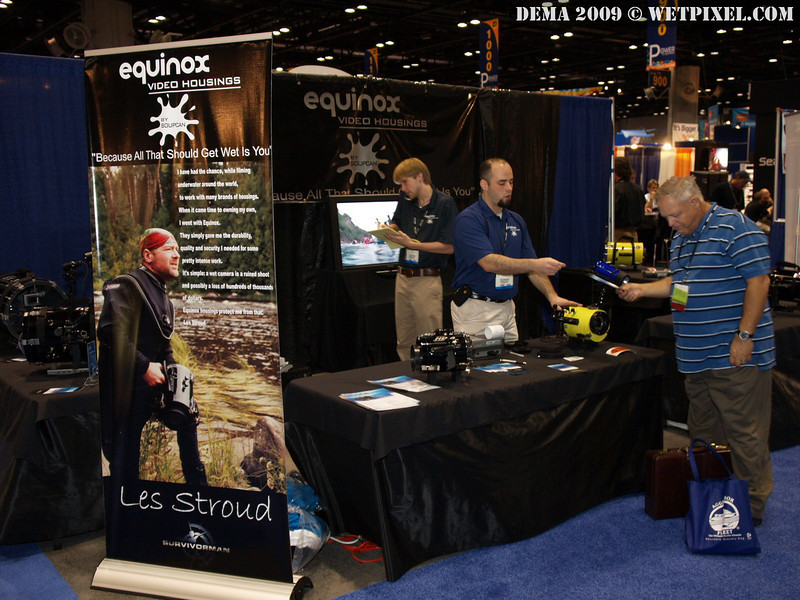 Eric Giannunzio assisting customers in the Equinox video housing booth at DEMA 2009.