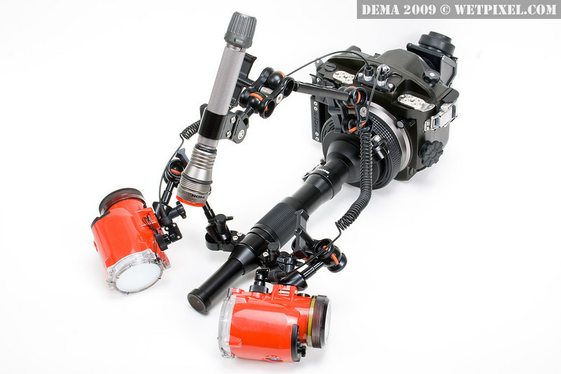 Full INON housing system with semi fish-eye relay system lens, two INON strobes, and modeling light