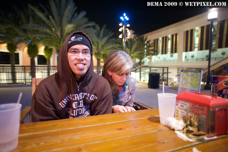 Adam Lau and Michaela Brockstedt stay warm at Adobe Gila's after DEMA 2009