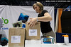 Michaela Brockstedt packs up the Wetpixel booth at the end of DEMA 2009