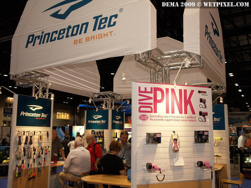 "Princeton Tec's booth displays their new ""Dive Pink"" and ""Island Pack"" initiatives."