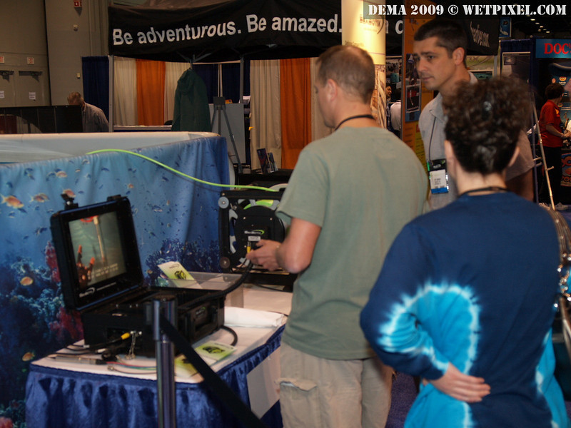 A DEMA attendee steering the Seabotix LBV rover in the demo pool