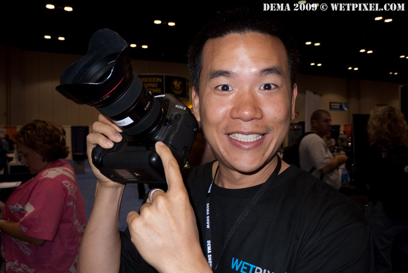 Eric Cheng holds the Canon 1D Mark IV dSLR