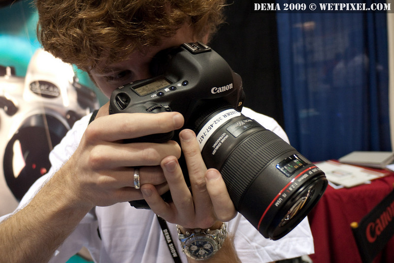 Matt Segal fondles a Canon 1D Mk IV at the Seacam booth