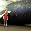 The Whalemobile was at the Leominster Public Library on Thursday to talk about whales and to show off a life size humpback whale that the kids could go into to learn more. Standing next to the life size humpback is Atherton Conklin, 6. SENTINEL & ENTERPRISE/JOHN LOVE