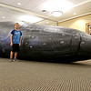 The Whalemobile was at the Leominster Public Library on Thursday to talk about whales and to show off a life size humpback whale that the kids could go into to learn more. Standing next to the life size humpback is Cameron Giannoni, 8, of Leominster. SENTINEL & ENTERPRISE/JOHN LOVE