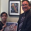 City Hearts student Samantha shows her photos to Roosevelt Elem. Principal Sal Aquino